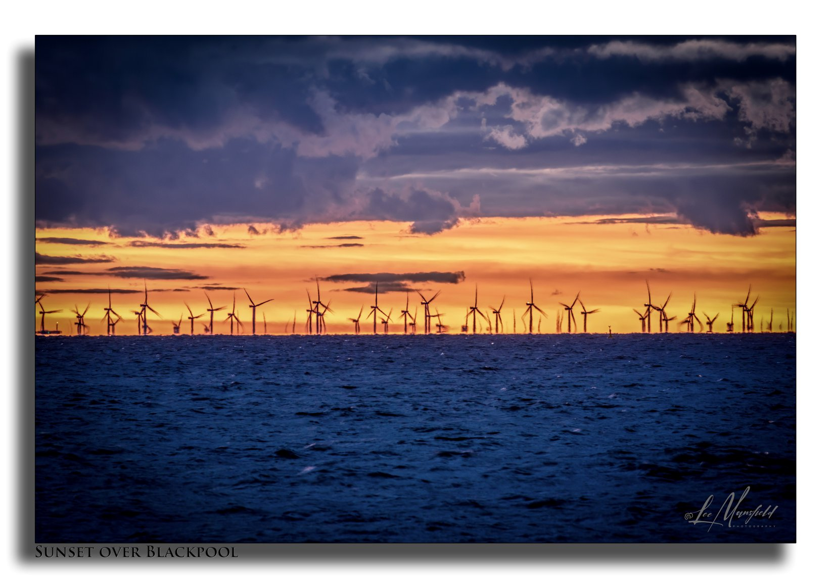 Windfarms at Sunset northern end of Blackpool seafront.